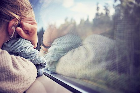 Woman sleeping near window in train Stock Photo - Premium Royalty-Free, Code: 6102-08942601