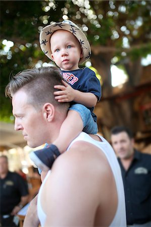 Father carrying son on shoulders Stock Photo - Premium Royalty-Free, Code: 6102-08996797