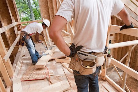 Carpenters working at a construction site Stock Photo - Premium Royalty-Free, Code: 6105-05396147