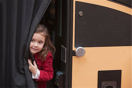 Girl peeking out from a bus Stock Photo - Premium Royalty-Free, Code: 6105-05396821