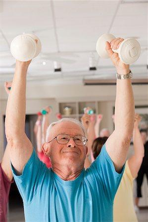 fitness older women gym - Senior exercise class doing arm stretches Stock Photo - Premium Royalty-Free, Code: 6105-05397148