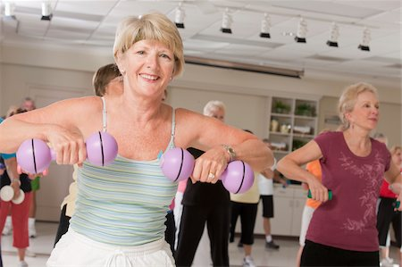 fitness older women gym - Senior exercise class working with dumbbells Stock Photo - Premium Royalty-Free, Code: 6105-05397149
