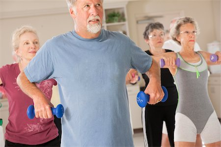 fitness older women gym - Seniors exercising with dumbbells in a health club Stock Photo - Premium Royalty-Free, Code: 6105-05397153