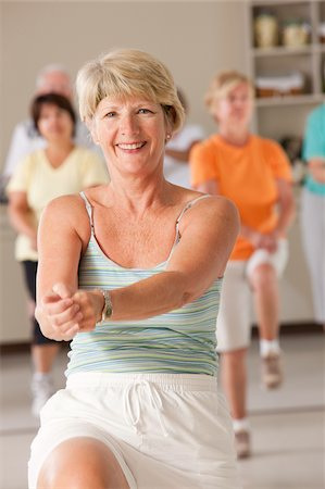 fitness older women gym - Senior exercise class doing stretches and cardio Stock Photo - Premium Royalty-Free, Code: 6105-05397157