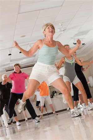 fitness older women gym - Senior exercise class doing stretches and cardio Stock Photo - Premium Royalty-Free, Code: 6105-05397158