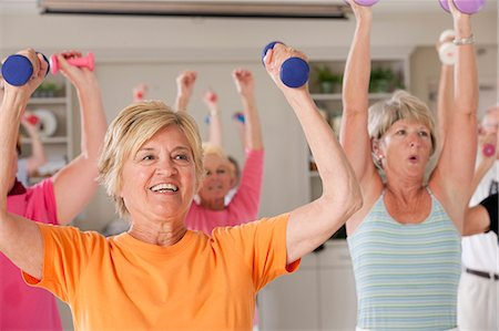 fitness older women gym - People exercising with dumbbells in a health club Stock Photo - Premium Royalty-Free, Code: 6105-05397159