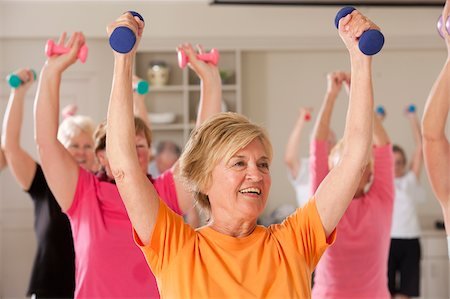 fitness older women gym - Seniors exercising with dumbbells in a health club Stock Photo - Premium Royalty-Free, Code: 6105-05397160
