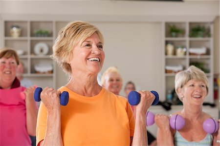 fitness older women gym - People exercising with dumbbells in a health club Stock Photo - Premium Royalty-Free, Code: 6105-05397161