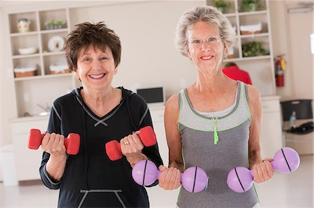 fitness older women gym - Portrait of two women exercising with dumbbells in a health club Stock Photo - Premium Royalty-Free, Code: 6105-05397166