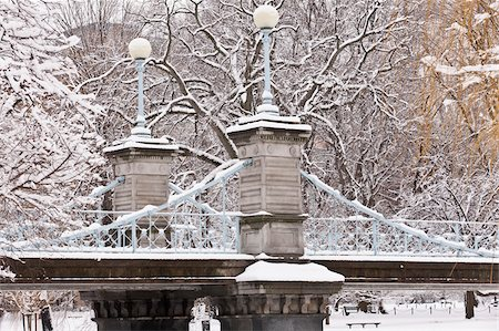 Snow covered trees with a footbridge in a public park, Boston Public Garden, Boston, Massachusetts, USA Stock Photo - Premium Royalty-Free, Code: 6105-05397173