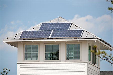 solar panel usa - Solar electric power panels on roof of Green Technology Home Stock Photo - Premium Royalty-Free, Code: 6105-05397238