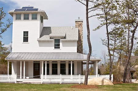 solar panel usa - Green Technology Home with wrap-around porch, light reflective roof and solar electric power panels Stock Photo - Premium Royalty-Free, Code: 6105-05397239