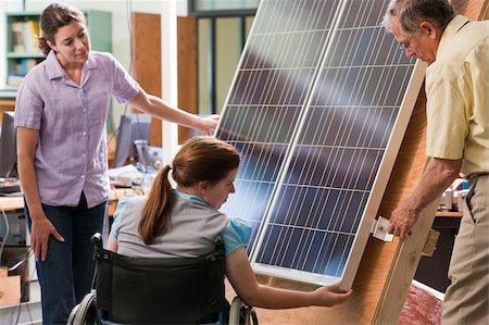 solar panel usa - Professor explaining mounting of photovoltaic module to engineering students Stock Photo - Premium Royalty-Free, Code: 6105-05953700