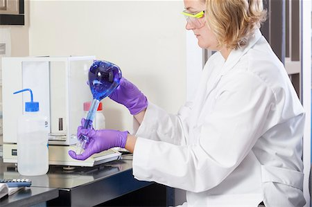Laboratory scientist hand mixing reagents in water sample flask Stock Photo - Premium Royalty-Free, Code: 6105-06703130