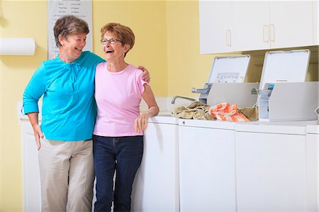 Senior women laughing in a laundry room Stock Photo - Premium Royalty-Free, Code: 6105-07521343