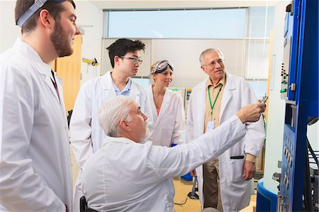 Professors explaining operation of water ultra purification system to engineering students in a laboratory Stock Photo - Premium Royalty-Free, Code: 6105-07521383