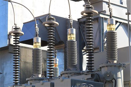 High voltage transformers at electric plant Stock Photo - Premium Royalty-Free, Code: 6105-07521394