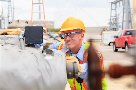 Electrical engineer examining pressure sensor at an electric power plant Stock Photo - Premium Royalty-Free, Code: 6105-07521453