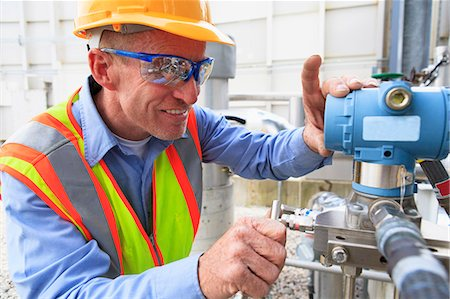 Engineer at electric power plant examining a transducer Stock Photo - Premium Royalty-Free, Code: 6105-07521476