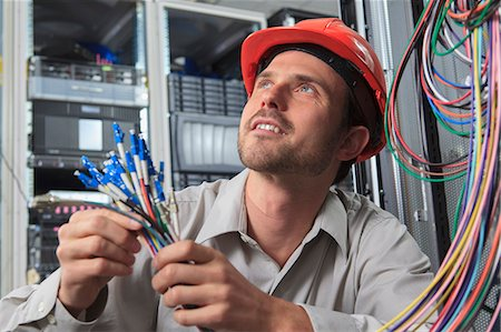 fibre optic - Network engineer preparing fiber cables in data center Stock Photo - Premium Royalty-Free, Code: 6105-07744493