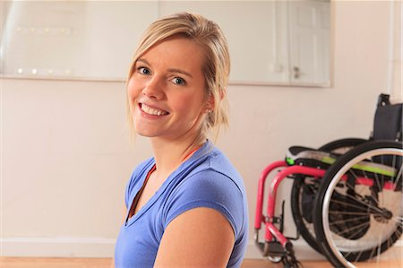 disable exercising - Young woman with a spinal cord injury with wheelchair in a yoga studio Stock Photo - Premium Royalty-Free, Code: 6105-07744427