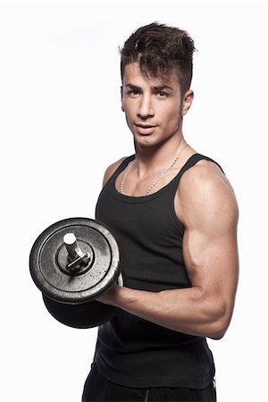 Young man lifting weights Stock Photo - Premium Royalty-Free, Code: 6106-05394307