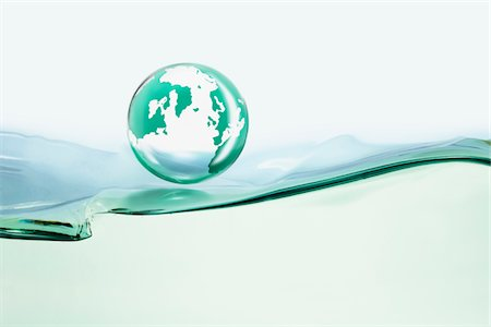 the globe over the oil Stock Photo - Premium Royalty-Free, Code: 6106-05394332