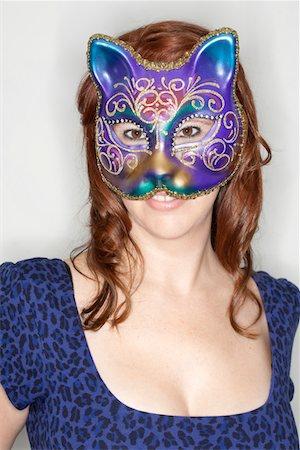 Woman in Venetian Cat mask. Stock Photo - Premium Royalty-Free, Code: 6106-05395227