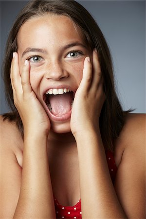 preteen open mouth - Portrait of girl, mouth open Stock Photo - Premium Royalty-Free, Code: 6106-05395684