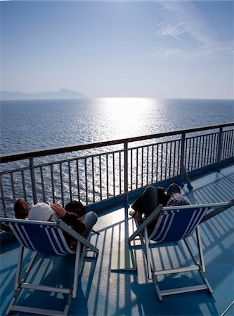 Couple aboard cruise ship Stock Photo - Premium Royalty-Free, Code: 6106-05440638