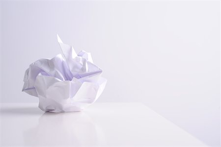 Crumpled paper ball on white Stock Photo - Premium Royalty-Free, Code: 6106-05442893