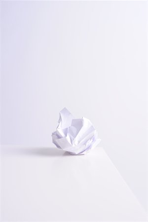 Crumpled paper ball on white Stock Photo - Premium Royalty-Free, Code: 6106-05442890