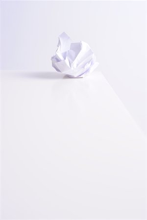 Crumpled paper ball on white Stock Photo - Premium Royalty-Free, Code: 6106-05442891