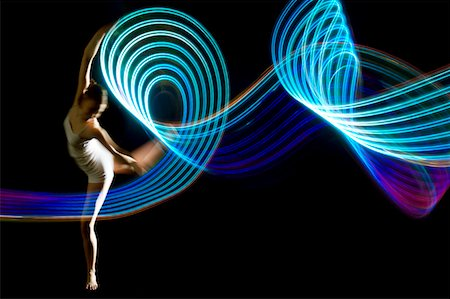 graceful dancer pirouettes in blue light trail Stock Photo - Premium Royalty-Free, Code: 6106-05443441