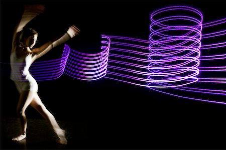 ballerina dances in purple graphic abstract light Stock Photo - Premium Royalty-Free, Code: 6106-05443442