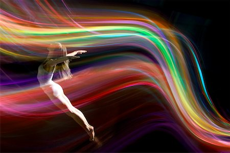 dancer balancing in multicolored abstract  light Stock Photo - Premium Royalty-Free, Code: 6106-05443436