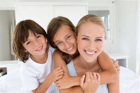 Portrait of a mother with son and daughter Stock Photo - Premium Royalty-Free, Code: 6106-05443789