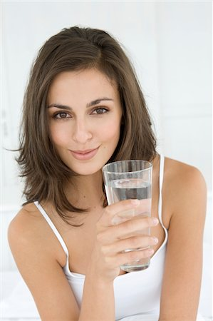 drinking water glass - Young woman with a glass of water Stock Photo - Premium Royalty-Free, Code: 6106-05443798