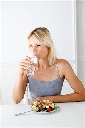 drinking water glass - Woman drinking water Stock Photo - Premium Royalty-Free, Code: 6106-05443712