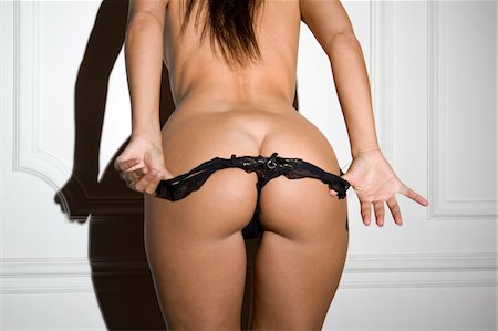 Female removing knickers Stock Photo - Premium Royalty-Free, Code: 6106-05443941