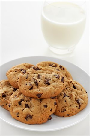 Chocolate Chip Cookies and Glass of Milk Stock Photo - Premium Royalty-Free, Code: 6106-05444126