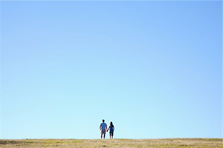 Mature couple holding hands on hilltop Stock Photo - Premium Royalty-Free, Code: 6106-05445389