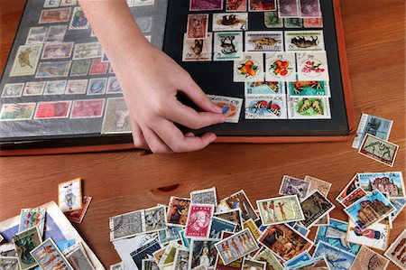 stamped - Collecting stamps Stock Photo - Premium Royalty-Free, Code: 6106-05445543