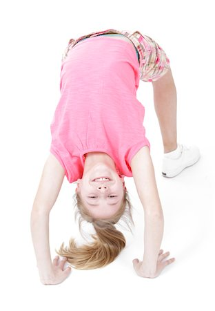 preteen girls stretching - Bend over backwards Stock Photo - Premium Royalty-Free, Code: 6106-05446355