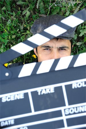 slate - Man behind a clapperboard Stock Photo - Premium Royalty-Free, Code: 6106-05447739