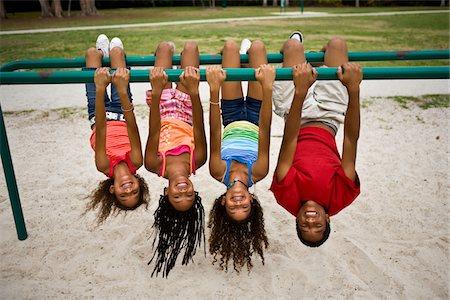 Kids hanging upside-down Stock Photo - Premium Royalty-Free, Code: 6106-05447884