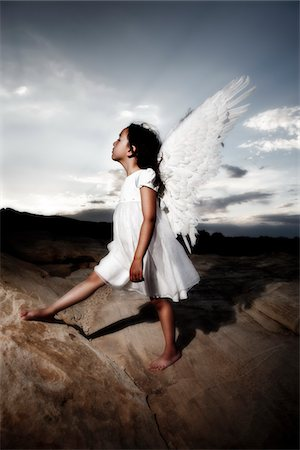 desert people dress photos - Little girl angel in the desert Stock Photo - Premium Royalty-Free, Code: 6106-05447923
