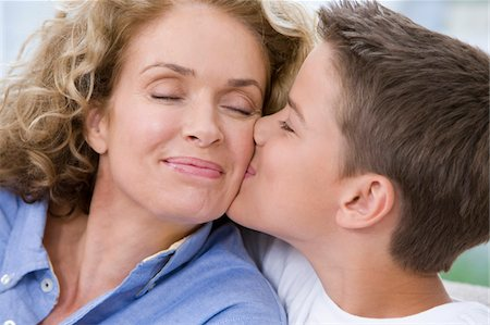Son (13-15) kissing mother, close-up Stock Photo - Premium Royalty-Free, Code: 6106-05452751