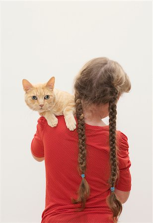 preteen girl pussy - Girl (9-11) holding cat, cat looking over shoulder Stock Photo - Premium Royalty-Free, Code: 6106-05456586