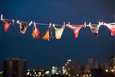 Women's underwear hanging on line, night Stock Photo - Premium Royalty-Free, Code: 6106-05457070
